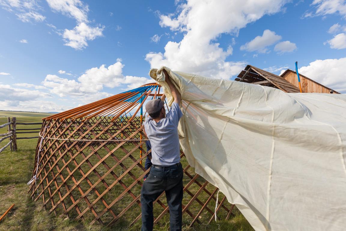 man building a yurt