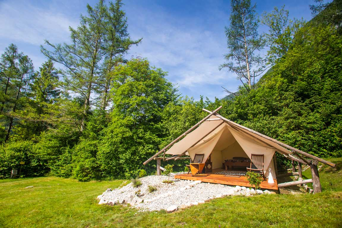 glamping tent surrounded by nature