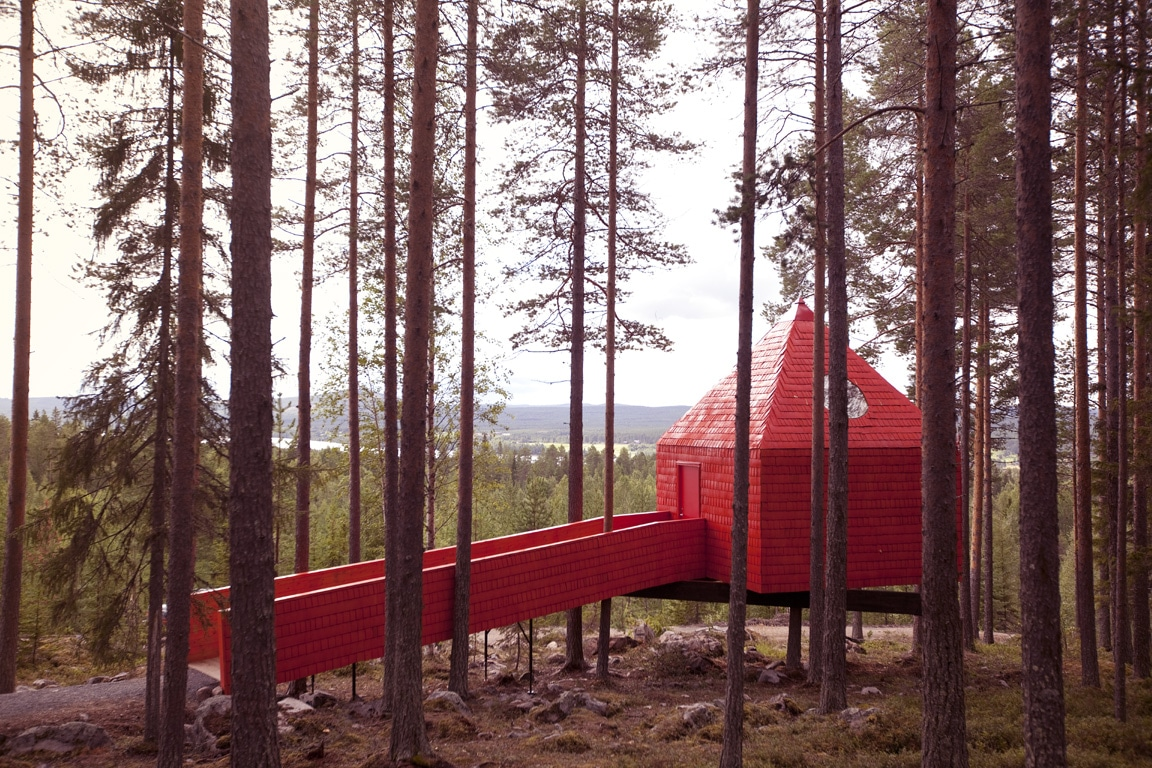 The Blue Clone treehouse in the forest at Treehotel Sweden